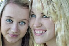 Closeup of two beautiful blond girl Royalty Free Stock Photos