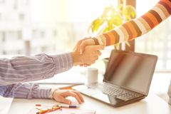Closeup of two business people shaking hands stock photography