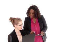 Closeup of two businesswoman working. Royalty Free Stock Photography