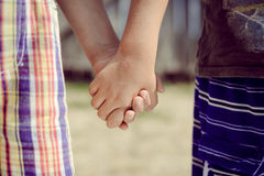 Closeup of two child's hands holding each other in Royalty Free Stock Image