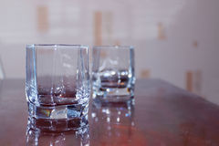 Closeup two cups of empty glass of whiskey Stock Image