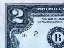 Closeup On A Two-Dollar Bill. Closeup of a US $2 banknote showing detail from the top-left corner of the 'face' side of the note Stock Photography