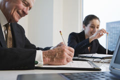 Closeup of two executives in conference meeting. Stock Photo