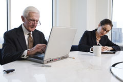Closeup of two executives in conference meeting. View of businesspeople working in an office stock images