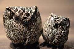 Closeup of two fabric owls sitting on a table Royalty Free Stock Images