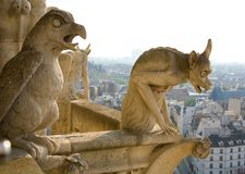 Closeup of two gargoyles on Notre-Dame de Paris. Closeup of two gargoyles on the top of Notre-Dame de Paris Royalty Free Stock Images