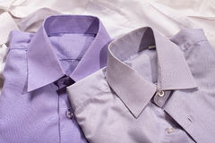 Closeup of two generic shirt with a line pattern Stock Photos