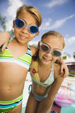 Closeup Of Two Girls Wearing Swim Goggles Stock Photo