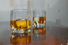 Closeup two glass cup with whiskey and ice Royalty Free Stock Image