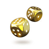 Closeup of two golden gambling dices Royalty Free Stock Photos