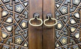 Closeup of two golden ring door knobs Royalty Free Stock Photos