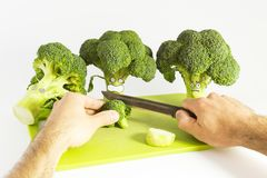 Fresh broccoli with scared cartoon style faces on white backgrou Royalty Free Stock Photo