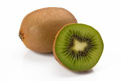 Closeup of two kiwis one full and the other cut stock photography