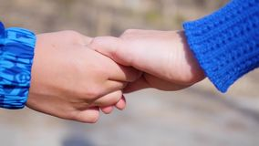 Closeup of two Lovers Joining Hands. Detail Silhouette of Man and Woman holding hands over. Love and Happiness concept. Closeup of two Lovers Joining Hands stock footage