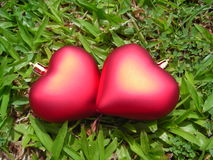 Closeup of two loving hearts. Made of christmas decoration symbolising love and romance Stock Photography