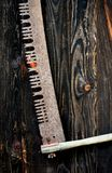 A closeup of a crosscut saw on a barn door. royalty free stock photos