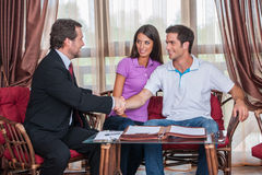 Closeup on two man handshaking to signed agreement Royalty Free Stock Images