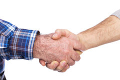 Closeup of two men shaking hands, agreement concept Royalty Free Stock Image
