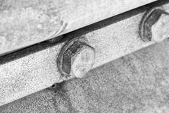 Closeup of two old bolts on a conrete structure stock image