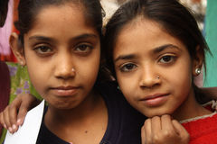 Closeup of two poor indian girls Stock Image