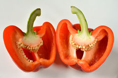 Closeup of two red halves capsicum. Macro view of two red halves capsicum on white background stock photography