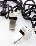 Two whistles with black cords Stock Photography