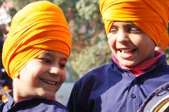 Closeup of two sikh children with saffron turbans Royalty Free Stock Image