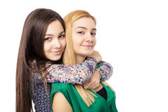 Closeup of two sisters hug having fun isolated Royalty Free Stock Photography