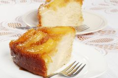 Closeup of two slices upside down pear cake Stock Image