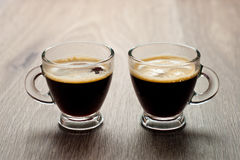Closeup of two small cups with espresso. Stock Photography