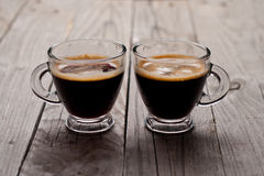 Closeup of two small cups with espresso. Stock Image
