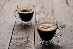 Closeup of two small cups with espresso. Stock Photos