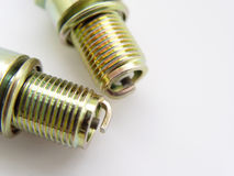 Closeup of two Spark Plugs. Together on white background stock photos