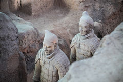Closeup of two terra cotta warriors in the pit Royalty Free Stock Image