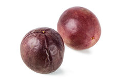 Closeup of two whole passion fruits Royalty Free Stock Photo