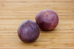 Closeup of two whole passion fruits Stock Photo