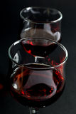 Closeup of Two Wineglasses Filled With Red Wine on Black Royalty Free Stock Photography