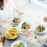 Closeup of two women having lunch together. At home Stock Images