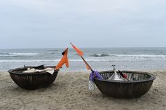 Closeup of two coconut boats on a lonely beach in Hoi An, Vietnam, Asia Stock Image