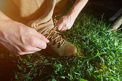 Closeup of tying hiking shoes Stock Images