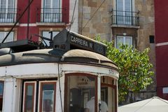 Closeup of Typical Yellow Vintage Tram in Lisbon, Portugal.  stock photo