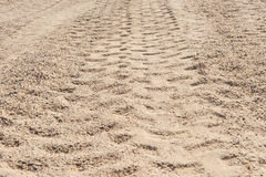 Closeup of 4x4 tyre tracks in the desert royalty free stock photos