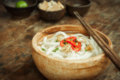 Closeup of udon noodle in wood bowl on wooden Royalty Free Stock Photos