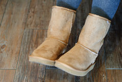 Closeup of Ugg boots. Closeup of brown Ugg boots with wooden background Stock Images