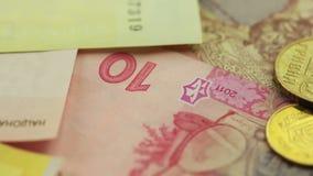 CloseUp Ukrainian Money. Camera flies over the Ukrainian money. Banknotes and coins. Close-up stock footage