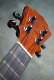 Closeup of ukulele headstock. And tuner Royalty Free Stock Photography
