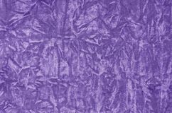 Closeup ultra violet color velvet fabric sample texture backdrop. Upholstery for decoration interior design or abstract background Royalty Free Stock Images