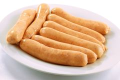 Closeup of uncooked chipolata sausages. Stock Images