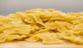 Closeup of uncooked italian pasta - farfalle Royalty Free Stock Image