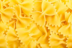 Closeup of Uncooked Italian Pasta - Farfalle. Italian macaroni farfale background close-up top view Stock Images